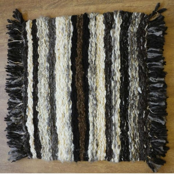 Natural fleece peg rug